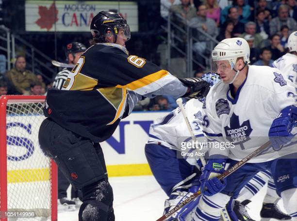 Jaromir Jagr of the Pittsburgh Penguins skates against Dmitri Yushkevich of the Toronto Maple Leafs during the 1999 Quarter Finals of the NHL playoff...
