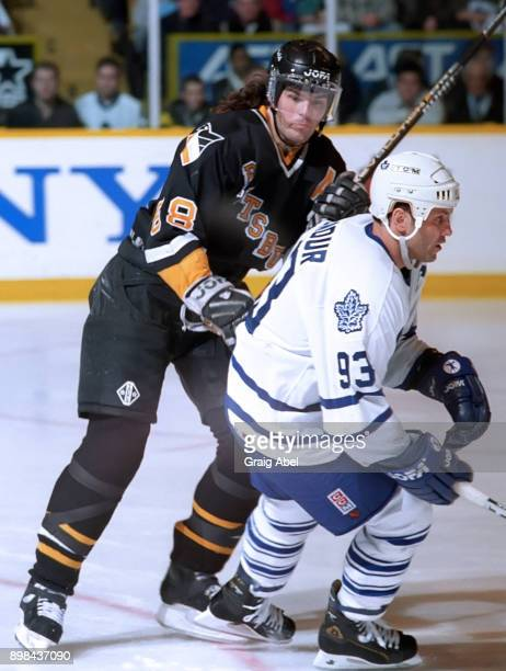 Jaromir Jagr of the Pittsburgh Penguins skates against Doug Gilmour of the Toronto Maple Leafs during NHL game action on February 12 1996 at Maple...