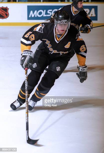 Jaromir Jagr of the Pittsburgh Penguins skates against the Toronto Maple Leafs during NHL game action on February 12 1996 at Maple Leaf Gardens in...
