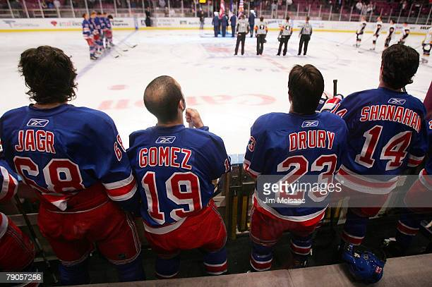 Jaromir Jagr Scott Gomez Chris Drury and Brendan Shanahan of the New York Rangers stand on the bench during the national anthem before playing the...