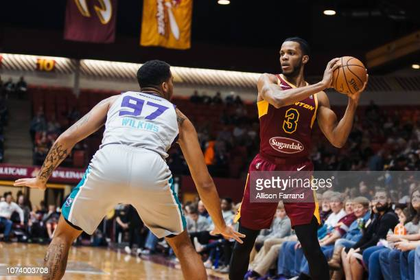 Jaron Blossomgame of the Canton Charge passes around Isaiah Wilkins of the Greensboro Swarm on December 15 2018 at the Canton Memorial Civic Center...