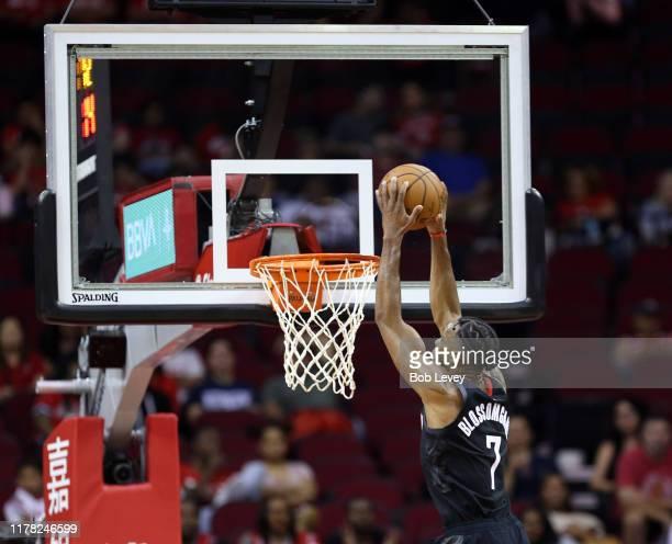 Jaron Blossomgame of the Houston Rockets dunks during the fourth quarter against the Shanghai Sharks at Toyota Center on September 30, 2019 in...