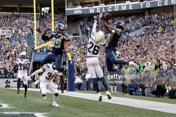 Jaron Brown of the Seattle Seahawks catches a pass for a touchdown past Casey Hayward Jr #26 of the Los Angeles Chargers in the first quarter at...