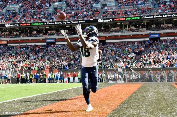 Jaron Brown of the Seattle Seahawks catches a touchdown pass during the second quarter against the Cleveland Browns at FirstEnergy Stadium on October...