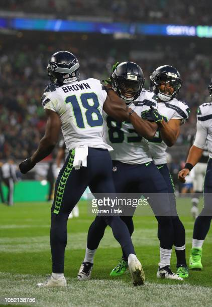 Jaron Brown of the Seattle Seahawks scores a touch down uring the NFL International Series game between Seattle Seahawks and Oakland Raiders at...