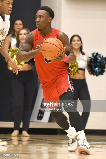 Jaron Cornish of the Stony Brook Seawolves looks to pass the ball during a college basketball game against the George Washington Colonials at the...