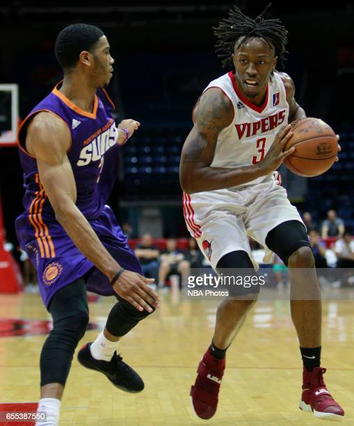 Jaron Johnson of the Rio Grande Valley Vipers moves the ball up the court on Shaquille Harrison of the Northern Arizona Suns at the State Farm Arena...