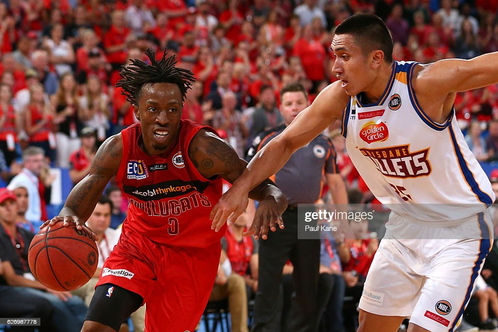 Jaron Johnson of the Wildcats drives to the basket against Reuben TeRangi of the Bullets during the round nine NBL match between the Perth Wildcats and the Brisbane Bullets at Perth Arena on December 1, 2016 in Perth, Australia.
