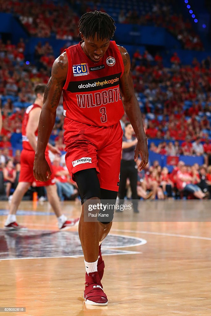Jaron Johnson of the Wildcats limps from the court with a suspected knww injury during the round eight NBL match between the Perth Wildcats and the Illawarra Hawks at the Perth Arena on November 27, 2016 in Perth, Australia.
