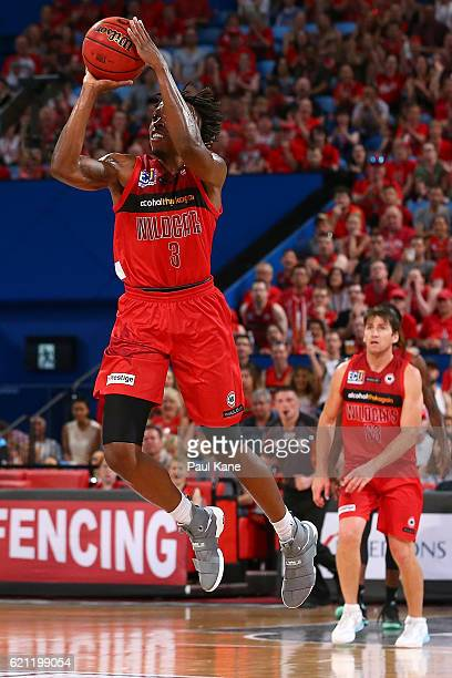 Jaron Johnson of the Wildcats shoots a 3 point buzzer beater during the round five NBL match between the Perth Wildcats and the Adelaide 36ers at...