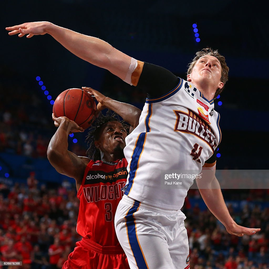 Jaron Johnson of the Wildcats works to the basket against Cam Bairstow of the Bullets during the round nine NBL match between the Perth Wildcats and the Brisbane Bullets at Perth Arena on December 1, 2016 in Perth, Australia.