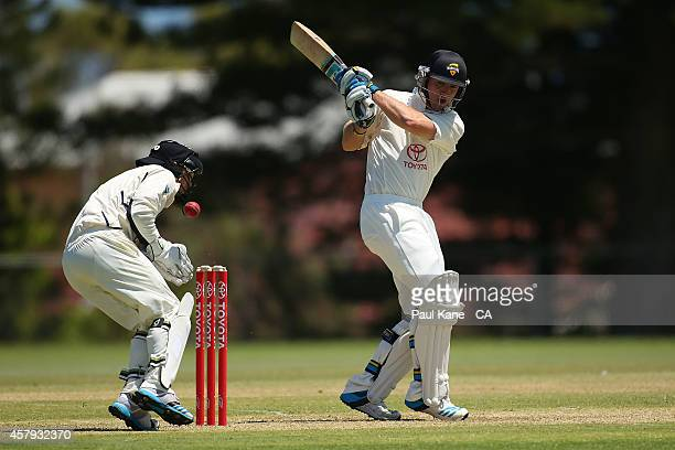 Jaron Morgan of Western Australia lets the ball go as Aaron Ayre of Victoria gets struck during the Futures League match between Western Australia...