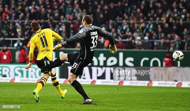 Jaroslav Drobny of Bremen kicks Marco Reus of Dortmund leading to his red card during the Bundesliga match between Werder Bremen and Borussia...