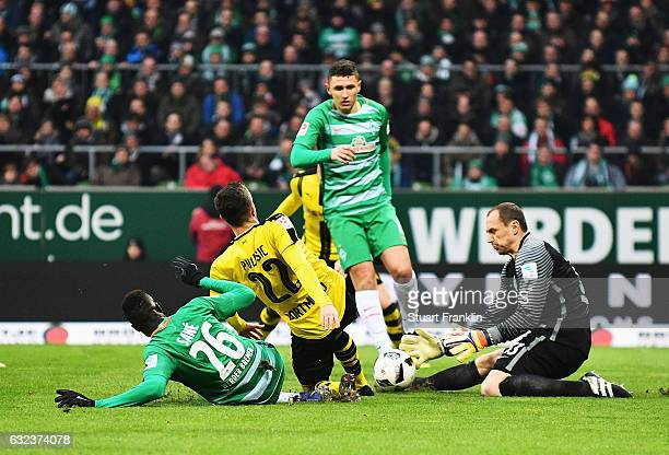 Jaroslav Drobny of Bremen makes a save from Christian Pulisic of Dortmund during the Bundesliga match between Werder Bremen and Borussia Dortmund at...