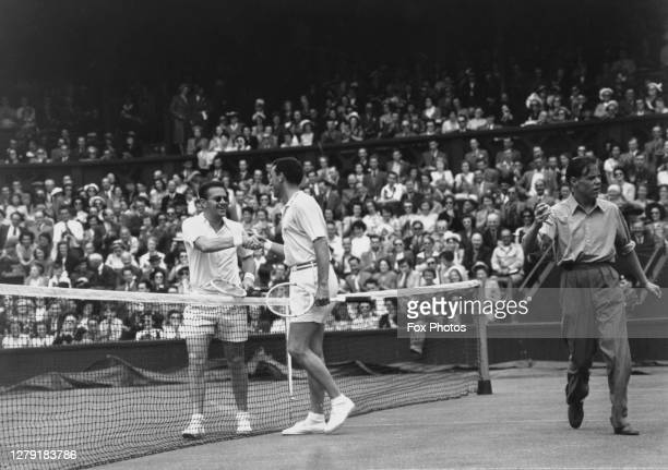 Jaroslav Drobny of Egypt and Christian Grandet of France shake hands over the net on Centre Court after their Men's Singles First Round match at the...