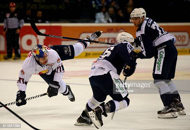Jaroslav Hafenrichter of Hamburg Freezers checks Keith Aucoin of Red Bull Muenchen during the DEL game between Hamburg Freezers and Red Bull Muenchen...