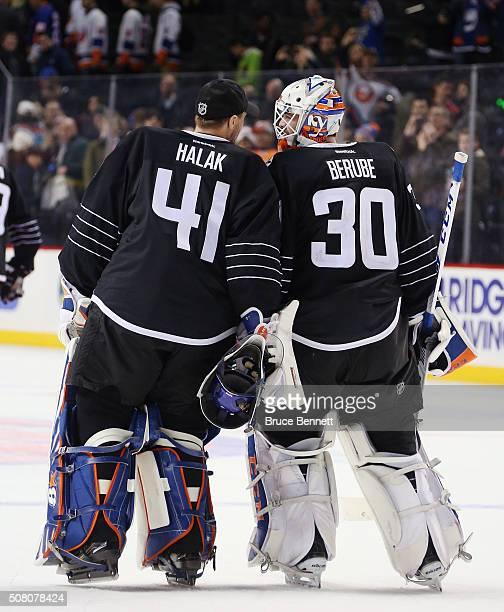 Jaroslav Halak and JeanFrancois Berube of the New York Islanders celebrate Berube's 53 victory over the Minnesota Wild at the Barclays Center on...