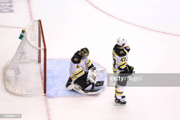 Jaroslav Halak and Torey Krug of the Boston Bruins react after losing 32 in the second overtime period in Game Five of the Eastern Conference Second...