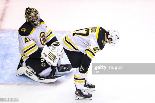 Jaroslav Halak and Torey Krug of the Boston Bruins react after losing 32 against the Tampa Bay Lightning in the second overtime period in Game Five...