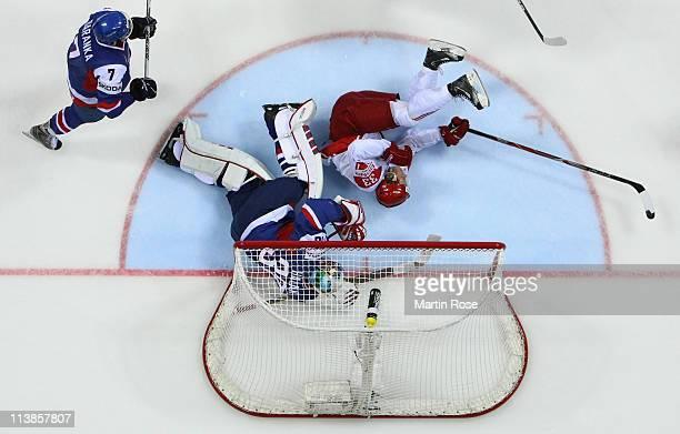 Jaroslav Halak goaltender of Slovakia makes a save on Julian Jakobsen of Denmark during the IIHF World Championship qualification match between...