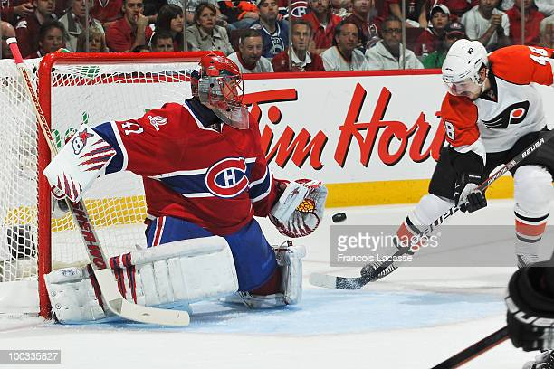Jaroslav Halak of Montreal Canadiens stops a shot from Danny Briere of Philadelphia Flyers in Game Four of the Eastern Conference Finals during the...