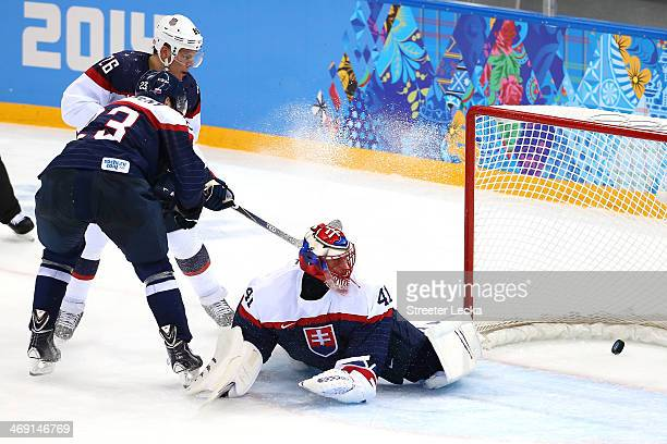 Jaroslav Halak of Slovakia lets in a goal by Paul Stastny of United States in the second period during the Men's Ice Hockey Preliminary Round Group A...