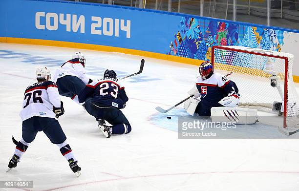 Jaroslav Halak of Slovakia makes a save against the United States during the Men's Ice Hockey Preliminary Round Group A game on day six of the Sochi...
