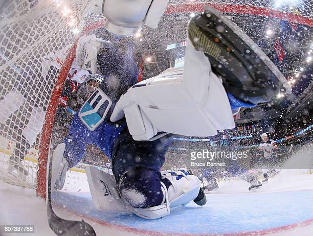 Jaroslav Halak of Team Europe is bumped by a member of Team USA during the second period during the World Cup of Hockey tournament at the Air Canada...