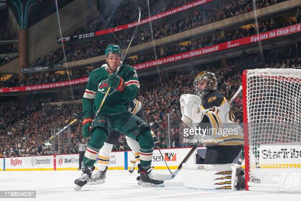 Jaroslav Halak of the Boston Bruins] defends his goal against Jordan Greenway of the Minnesota Wild during the game at the Xcel Energy Center on...