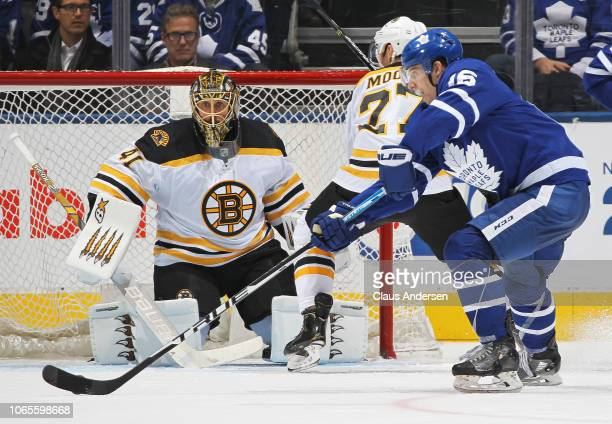 Jaroslav Halak of the Boston Bruins gets set to face a backhand shot from Mitchell Marner of the Toronto Maple Leafs during an NHL game at Scotiabank...