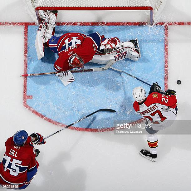 Jaroslav Halak of the Montreal Canadiens blocks the shot of Steve Reinprecht of the Florida Panthers during the NHL game on March 25, 2010 at the...