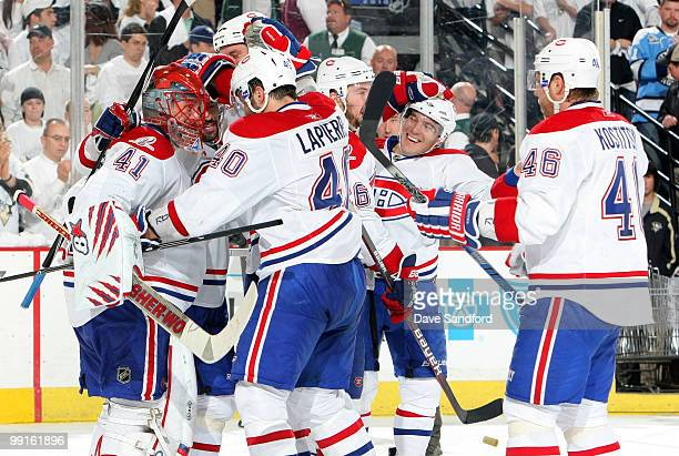 Jaroslav Halak of the Montreal Canadiens is congratulated by teammates after defeating the Pittsburgh Penguins in Game Seven of the Eastern...