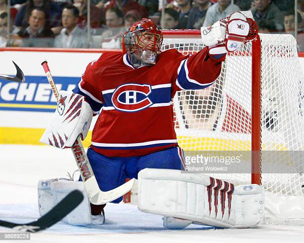 Jaroslav Halak of the Montreal Canadiens makes a glove save on the puck in Game Six of the Eastern Conference Quarterfinals against the Washington...