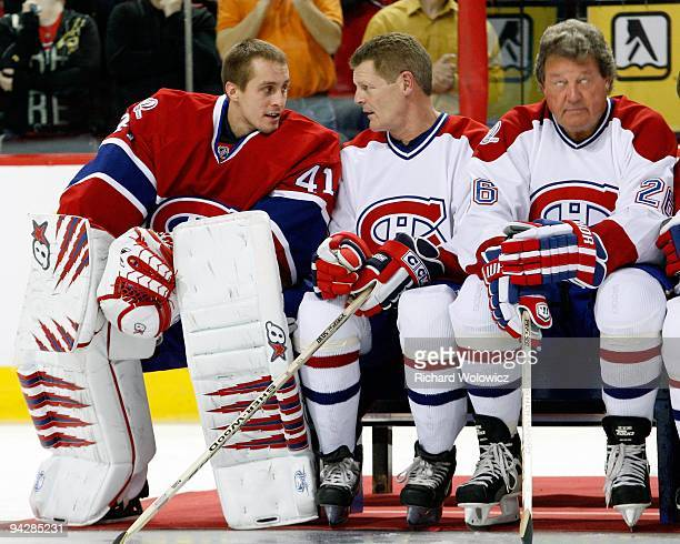 Jaroslav Halak of the Montreal Canadiens talks to former Montreal Canadien Chris Nilan during the Centennial Celebration ceremonies prior to the NHL...