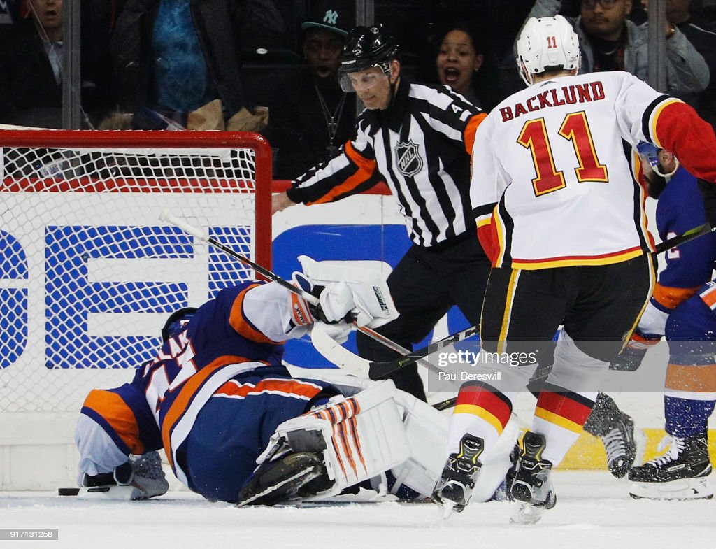 Jaroslav Halak #41 of the New York Islanders allows the game-winning goal by Matthew Tkachuk #19 of the Calgary Flames (not pictured) during the third period of a 3-2 loss at Barclays Center on February 11, 2018 in the Brooklyn borough of New York City.