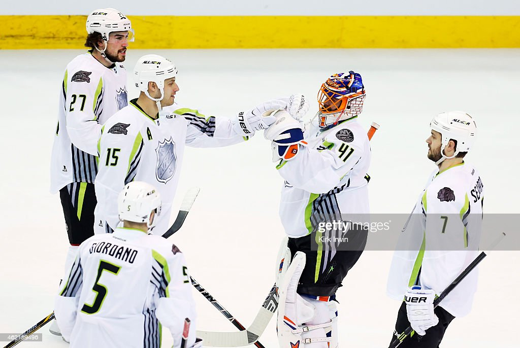 Jaroslav Halak #41 of the New York Islanders and Team Toews Ryan Getzlaf #15 of the Anaheim Ducks and Team Toews and teammates celebrate their 17 to 12 win over Team Foligno during the 2015 Honda NHL All-Star Game at Nationwide Arena on January 25, 2015 in Columbus, Ohio.