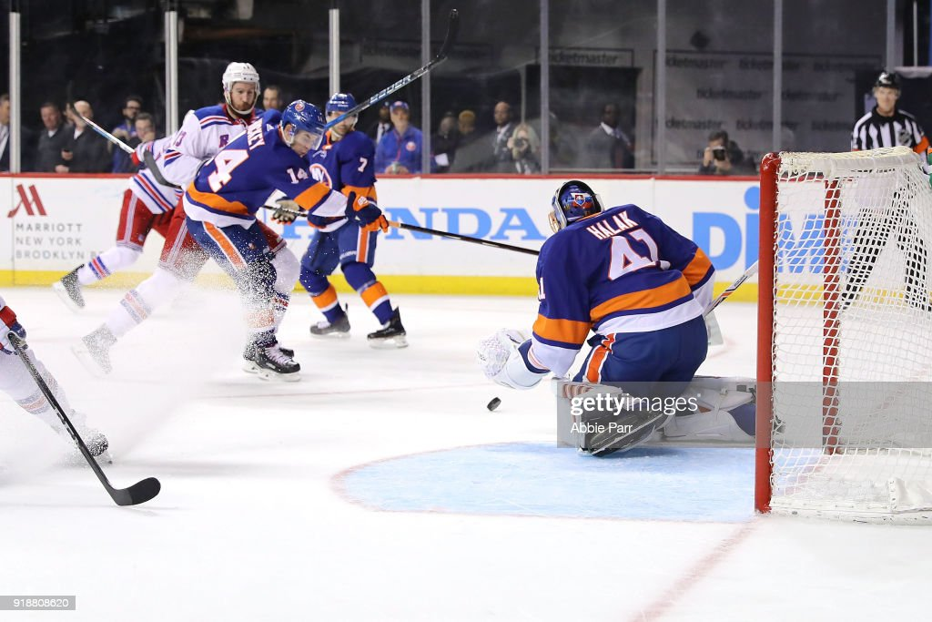 Jaroslav Halak #41 of the New York Islanders blocks a shot against the New York Rangers in the first period during their game at Barclays Center on February 15, 2018 in the Brooklyn borough of New York City.