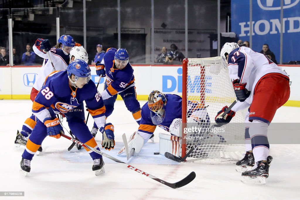 Jaroslav Halak #41 of the New York Islanders blocks a shot by Josh Anderson #77 of the Columbus Blue Jackets in the first period during their game at Barclays Center on February 13, 2018 in the Brooklyn borough of New York City.