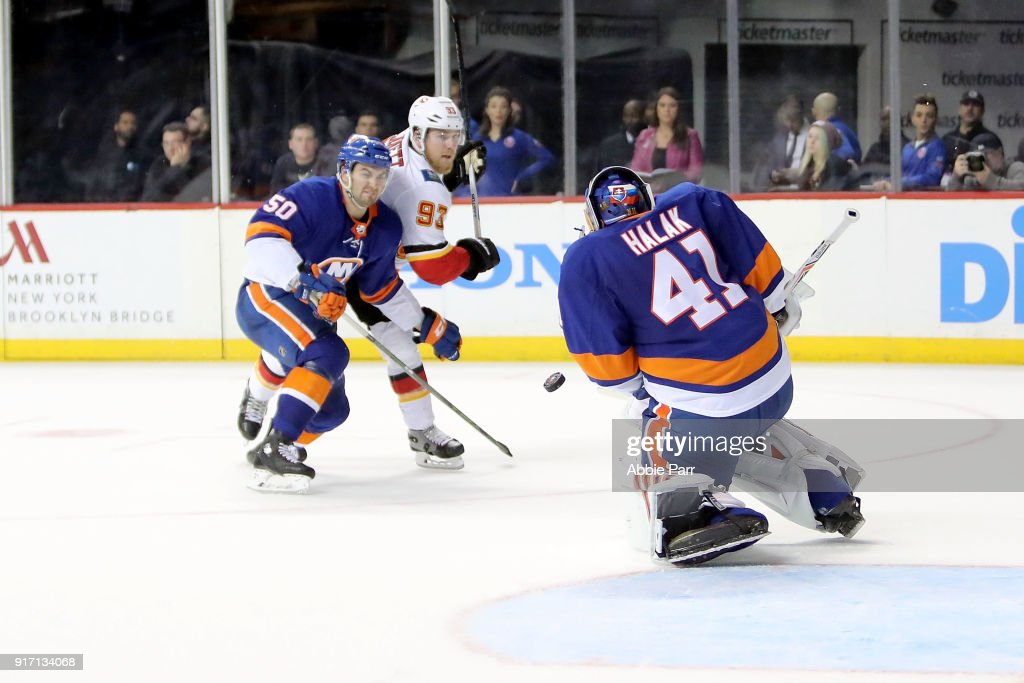 Jaroslav Halak #41 of the New York Islanders blocks a shot by Sam Bennett #93 of the Calgary Flames in the third period during their game at Barclays Center on February 11, 2018 in the Brooklyn borough of New York City.