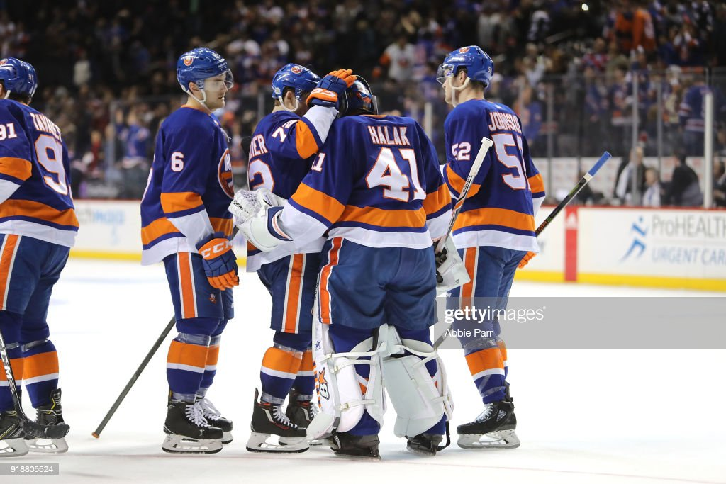 Jaroslav Halak #41 of the New York Islanders celebrates with teammates after their 3-0 win against the New York Rangers during their game at Barclays Center on February 15, 2018 in the Brooklyn borough of New York City.