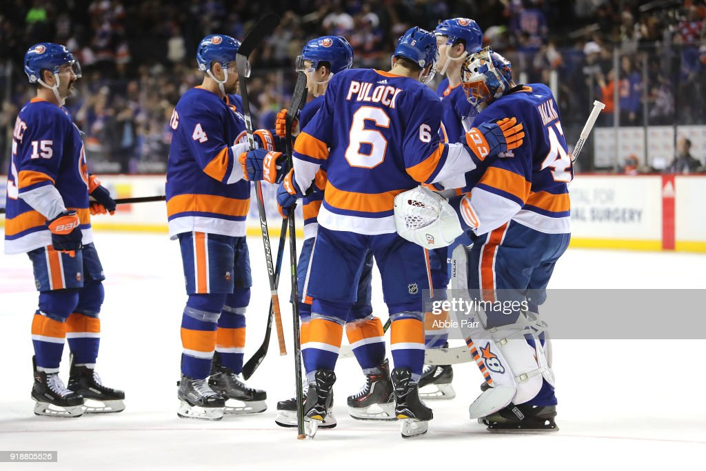 Jaroslav Halak #41 of the New York Islanders (R) celebrates with teammates after their 3-0 win against the New York Rangers during their game at Barclays Center on February 15, 2018 in the Brooklyn borough of New York City.