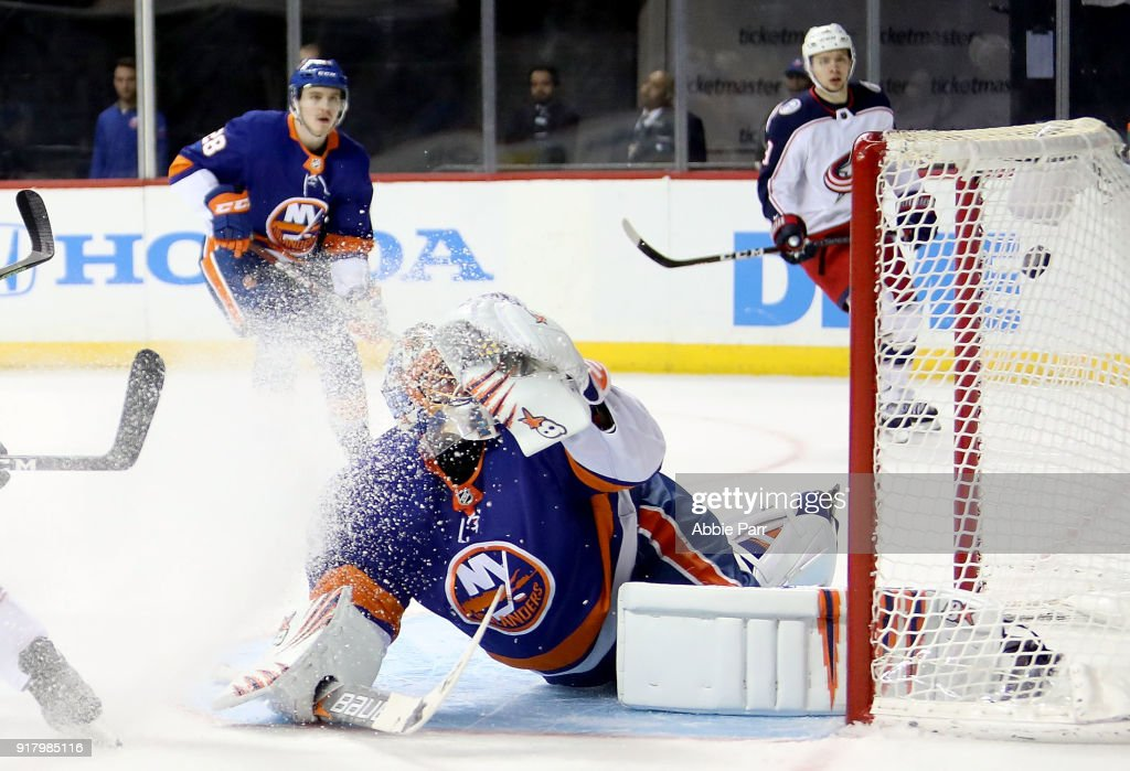 Jaroslav Halak #41 of the New York Islanders gives up a goal to Artemi Panarin #9 of the Columbus Blue Jackets in the third period during their game at Barclays Center on February 13, 2018 in the Brooklyn borough of New York City.