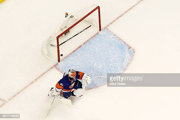 Jaroslav Halak of the New York Islanders looks on after giving up the game winning overtime goal to Danny DeKeyser of the Detroit Red Wings at the...
