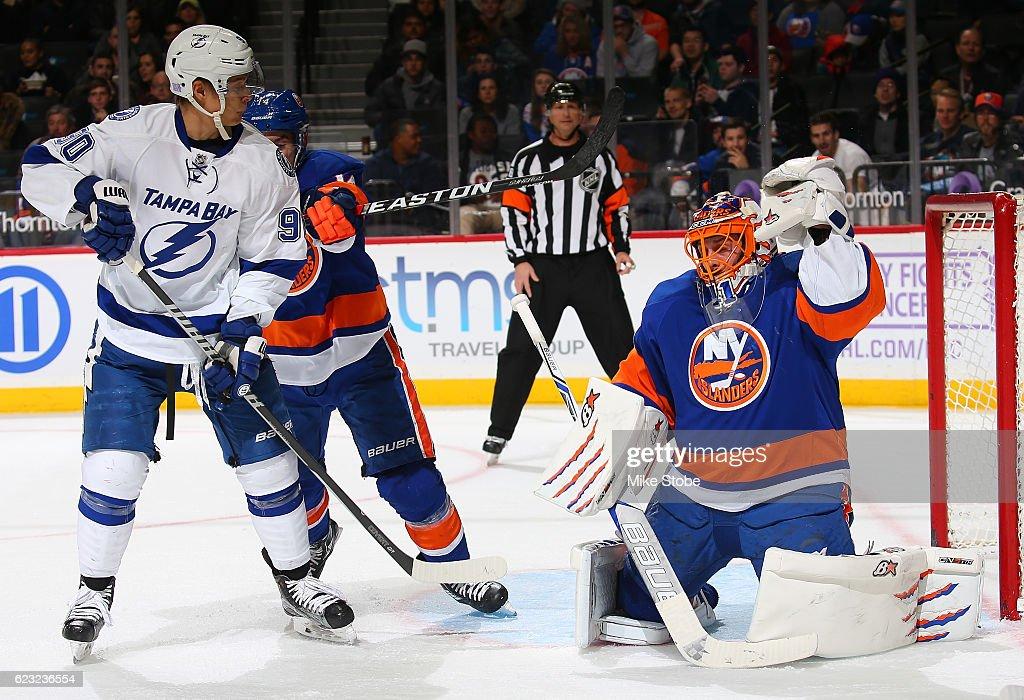 low priced 8f75a e8e00 Jaroslav Halak of the New York Islanders makes a glove save ...