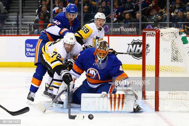 Jaroslav Halak of the New York Islanders makes a pad save on Patric Hornqvist of the Pittsburgh Penguins during the second period at Barclays Center...
