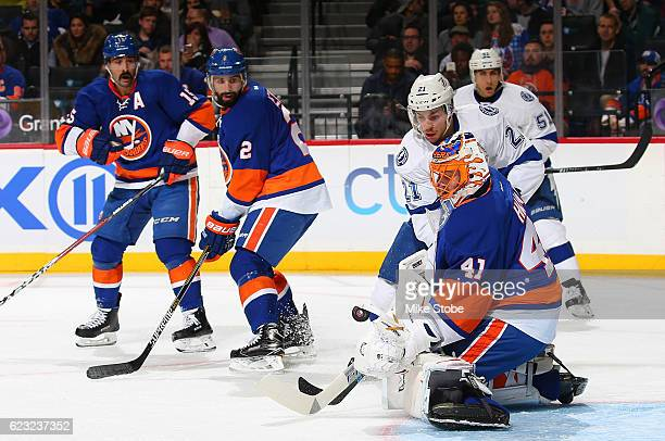 Jaroslav Halak of the New York Islanders makes a save against Brayden Point of the Tampa Bay Lightning at the Barclays Center on November 14 2016 in...