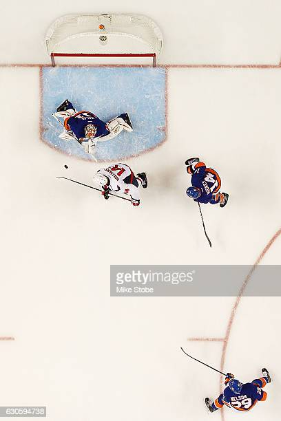 Jaroslav Halak of the New York Islanders makes a save against Justin Williams of the Washington Capitals at the Barclays Center on December 27 2016...