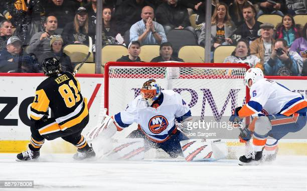Jaroslav Halak of the New York Islanders makes a save on Phil Kessel of the Pittsburgh Penguins at PPG Paints Arena on December 7 2017 in Pittsburgh...