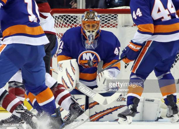 Jaroslav Halak of the New York Islanders makes the chest save during the second period against the Arizona Coyotes at the Barclays Center on October...