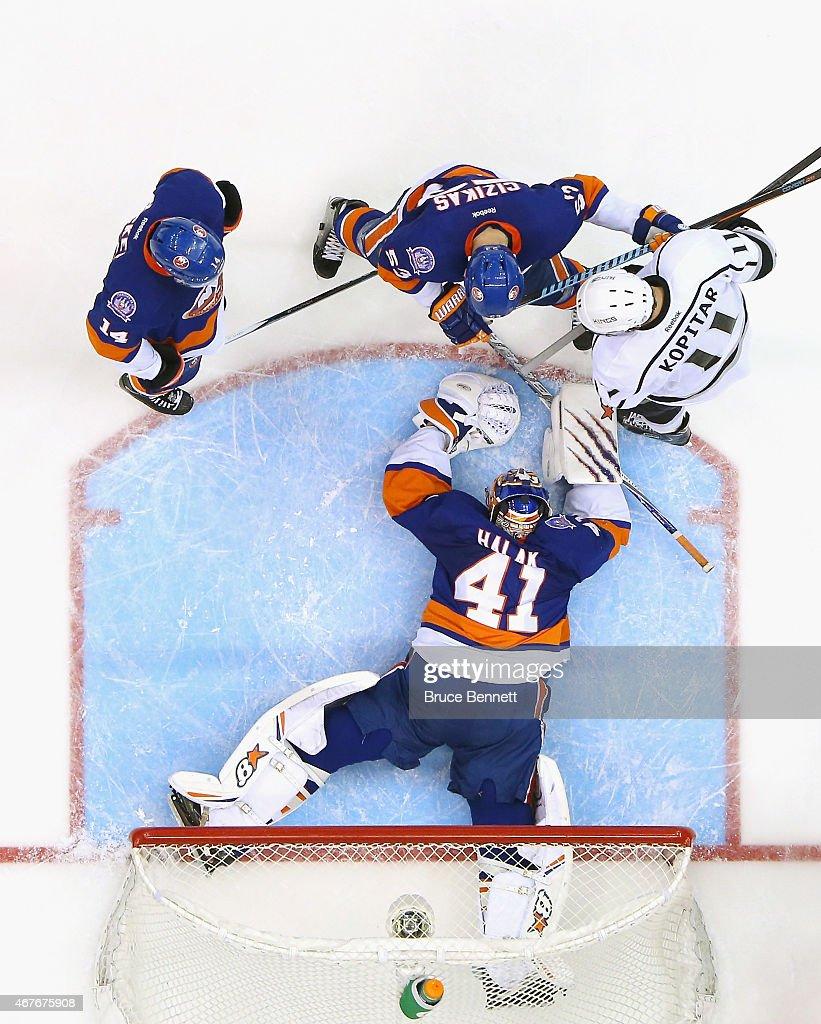 Jaroslav Halak #41 of the New York Islanders makes the save against the Los Angeles Kings at the Nassau Veterans Memorial Coliseum on March 26, 2015 in Uniondale, New York. The Kings defeated the Islanders 3-2.